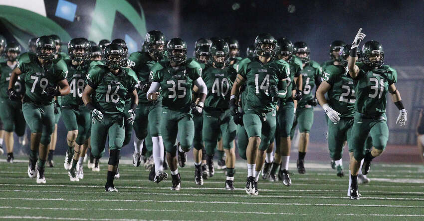 The Reagan Rattlers take the field for their game against the Johnson Jaguars at Comalander Stadium on Friday, Oct. 25, 2013.