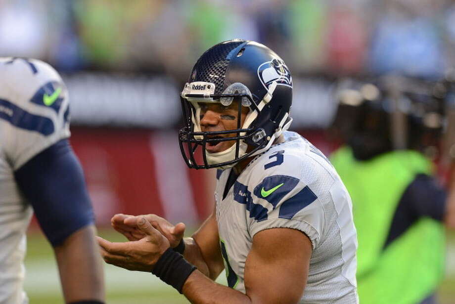 """Q: Were there any specific changes that have helped the Seahawks improve their game on the road?RW:""""I think the biggest thing that I noticed last year, and after evaluating and taking that bye week and evaluating the start of the season and everything -- I take tons of notes, as you guys know -- but just kind of observing myself and going through, self-evaluating each game and just going through the emotions of each game. Just literally going through each play, and kind of noting each play of what I was thinking, what I was feeling during that play. And it's usually around play 25 to 40 where something in the game happens; whether it's good or bad, something happens.   """"And that's kind of the ebb and flow of the game; that's just natural. Because obviously, when you go into the beginning of the game -- start the first quarter -- everybody is ready to go, that type of thing. Or when the game is at the end of the game, it's the fourth quarter, everybody is really focused because it's the end of the game. But in between, that second and third quarter, is where you really have to be great I think too. So that's something I noticed and something that I talked to Coach (Pete) Carroll about. And whatever it takes to make sure that -- as a collective effort, as an entire football team, but also myself -- really be in tune with that situation."""" Photo: Norm Hall, Getty Images / 2013 Norm Hall"""