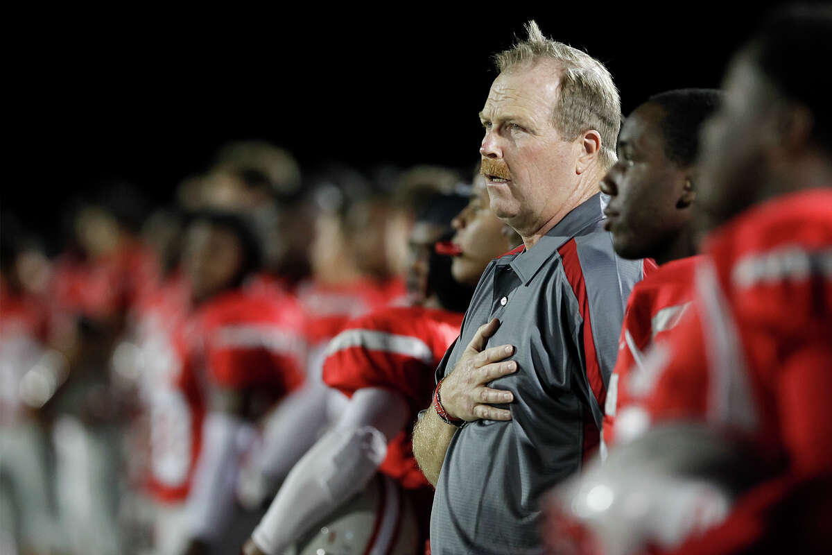 Judson coach Mark Smith stands at attention with his team as the National Anthem is sung prior to ther game with San Marcos at Rutledge Stadium on Friday, Oct. 25, 2013. Judson set a state record for consecutive winning seasons at 37 with the victory over the Rattlers. MARVIN PFEIFFER/ mpfeiffer@express-news.net