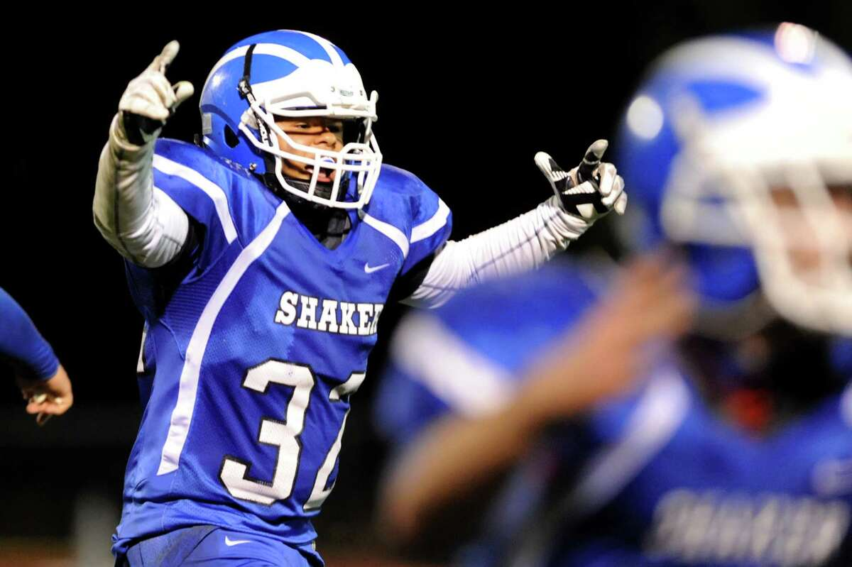 Shaker's Nick Brown, left, reacts when they block a Shenendehowa field goal in the final seconds of their Class AA quarterfinal football game on Friday, Oct. 25, 2013, at Shaker High in Latham, N.Y. (Cindy Schultz / Times Union)