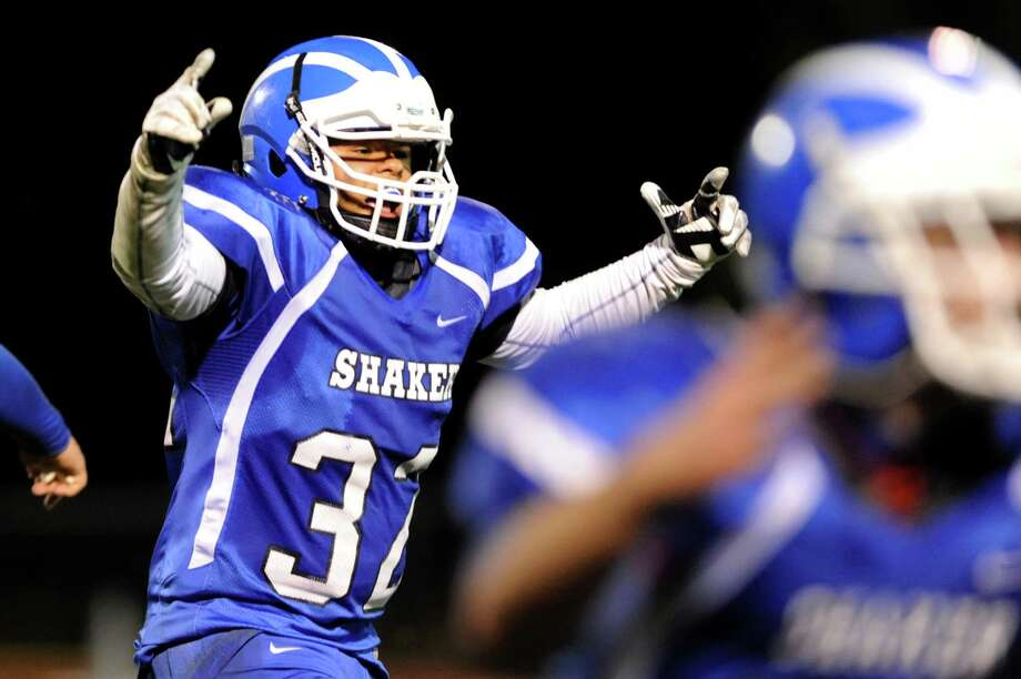 Shaker's Nick Brown, left, reacts when they block a Shenendehowa field goal in the final seconds of their Class AA quarterfinal football game on Friday, Oct. 25, 2013, at Shaker High in Latham, N.Y. (Cindy Schultz / Times Union) Photo: Cindy Schultz / 00024383A