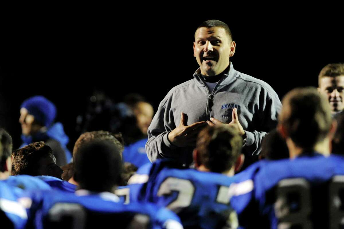 Shaker head coach Greg Sheeler talks with his team after they win their Class AA quarterfinal football game 23-21 over Shenendehowa on Friday, Oct. 25, 2013, at Shaker High in Latham, N.Y. (Cindy Schultz / Times Union)