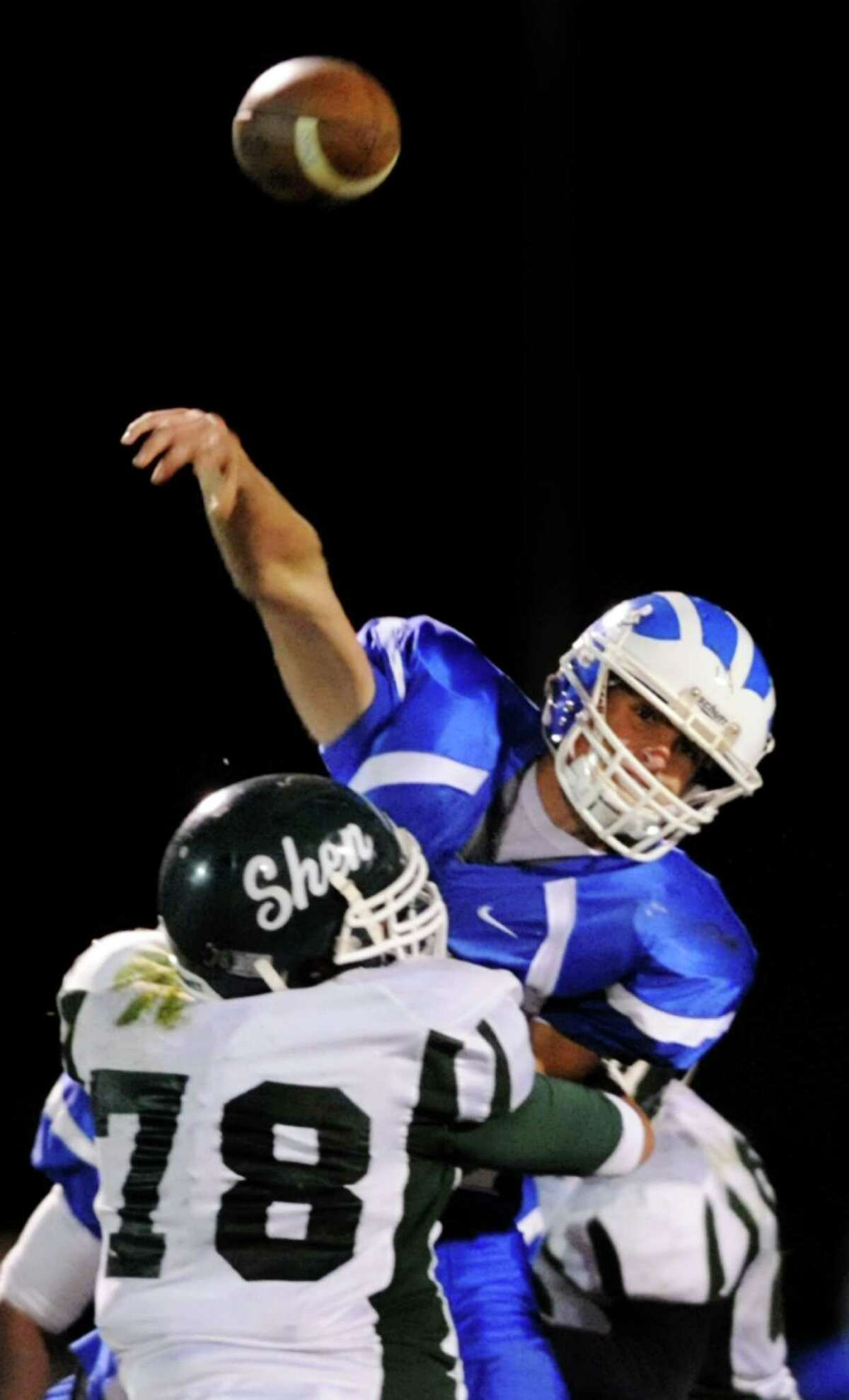 Shaker's Matt Woods throws a pass during their Class AA quarterfinal football game against Shenendehowa on Friday, Oct. 25, 2013, at Shaker High in Latham, N.Y. (Cindy Schultz / Times Union)