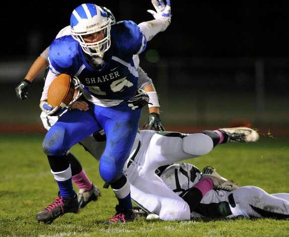 Shaker's Sean Egan, left, gains yards during their Class AA quarterfinal football game against Shenendehowa on Friday, Oct. 25, 2013, at Shaker High in Latham, N.Y. (Cindy Schultz / Times Union) Photo: Cindy Schultz / 00024383A