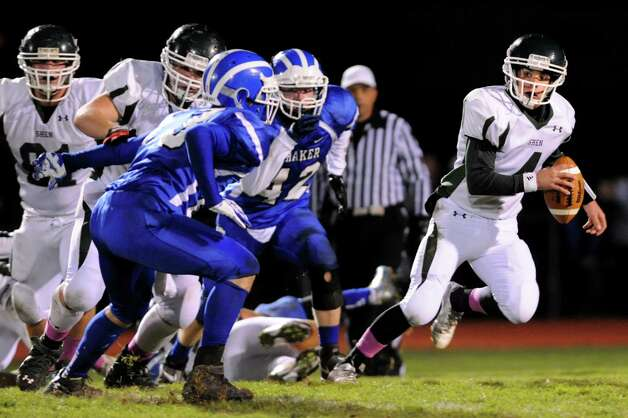 Shenendehowa's quarterback Ben Sibson, right, scrambles as he looks for an open man during their Class AA quarterfinal football game against Shaker on Friday, Oct. 25, 2013, at Shaker High in Latham, N.Y. (Cindy Schultz / Times Union) Photo: Cindy Schultz / 00024383A