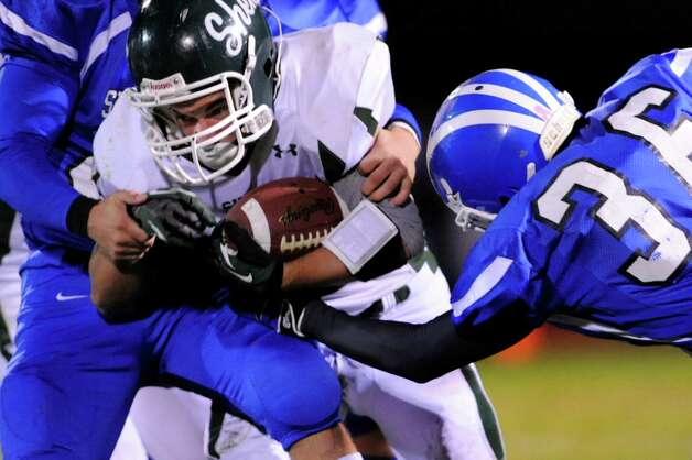 Shenendehowa's Jeremiah Smith, center, battles Shaker's defense during their Class AA quarterfinal football game on Friday, Oct. 25, 2013, at Shaker High in Latham, N.Y. (Cindy Schultz / Times Union) Photo: Cindy Schultz / 00024383A