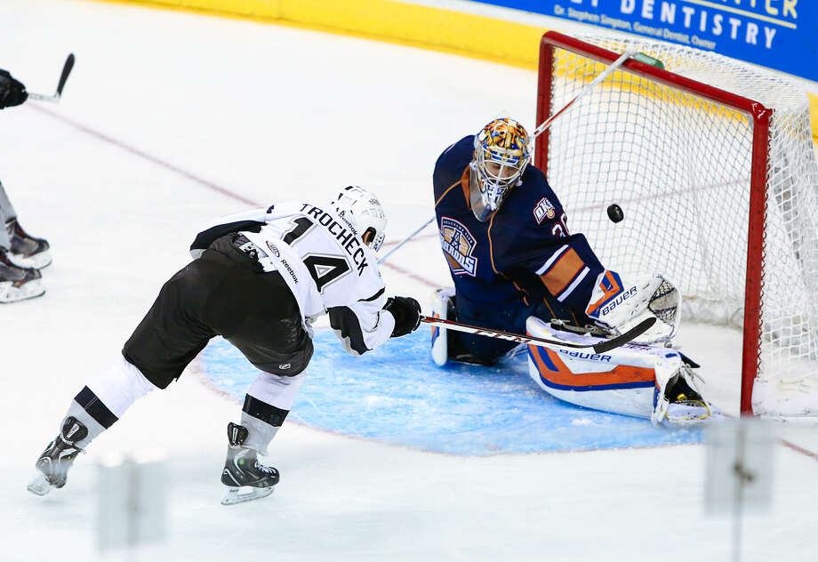Rampage center Vincent Trocheck scores a second-period goal despite the efforts of Oklahoma City goalkeeper Richard Bachman. The Rampage suffered their third straight loss. Photo: Josh Huskin / Pressphotointl.com