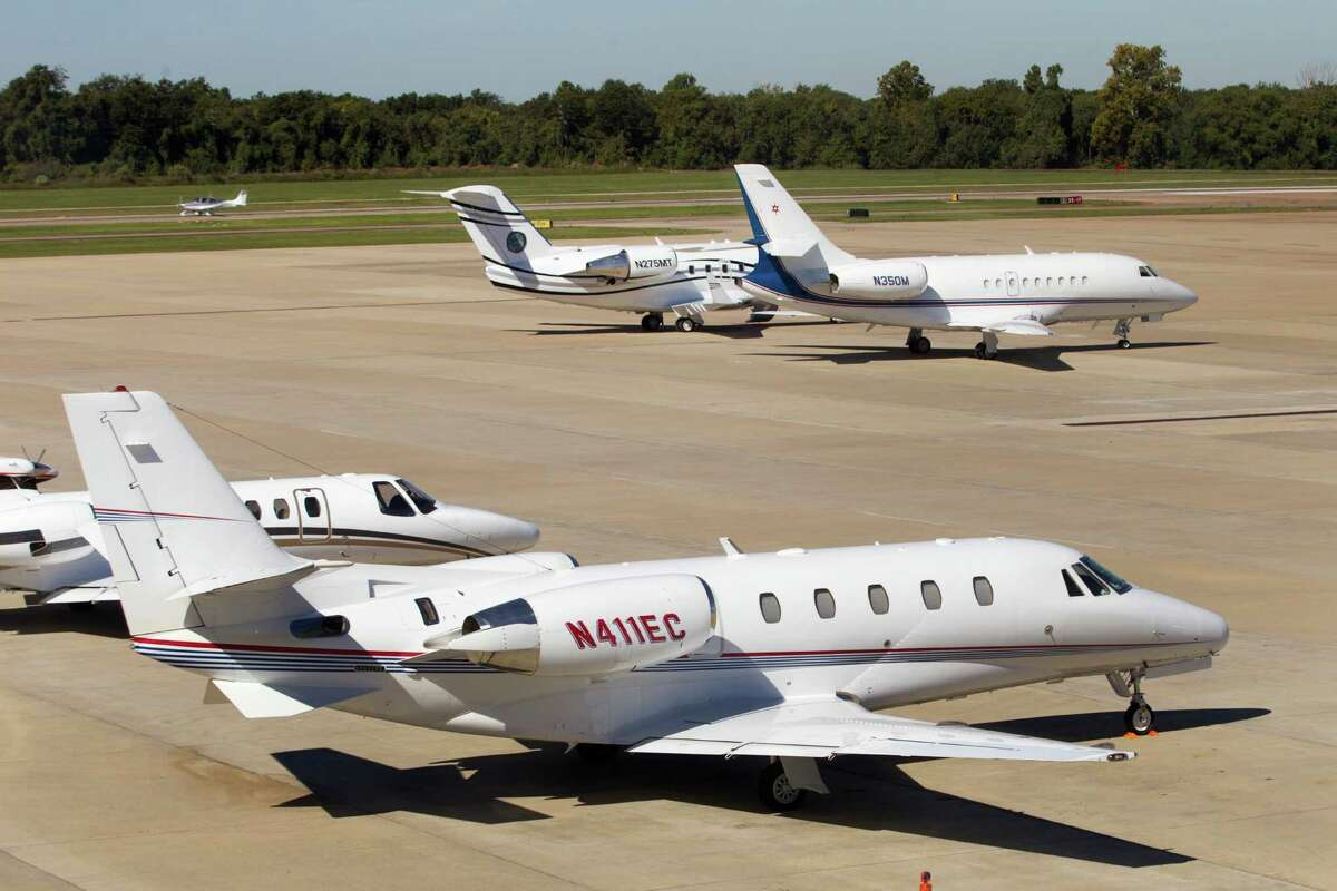 Various aircraft are shown parked on the tarmac at the Sugar Land Regional Airport October 2013 in Sugar Land.