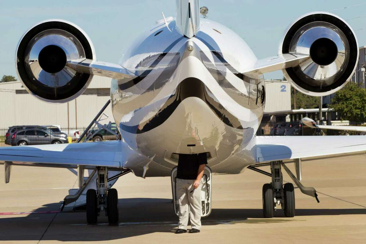 A private plane sits on the runway at Sugar Land Regional Airport in this file photo from 2013.