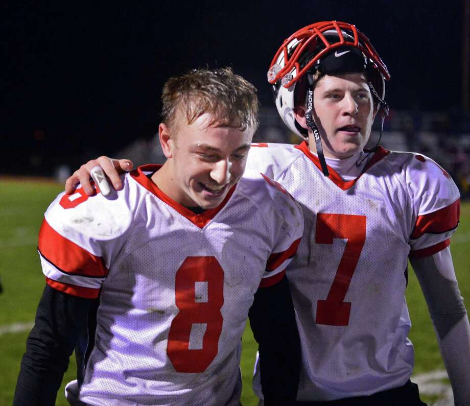 Guilderland's #8 Andrew Sentz, left, is congradulated by QB #7 Frank Gallo after Sentz kicked a final second field goal to win their Class AA quarterfinal football game against Colonie Friday Oct. 24, 2013, in Colonie, NY.  (John Carl D'Annibale / Times Union) Photo: John Carl D'Annibale / 00024382A