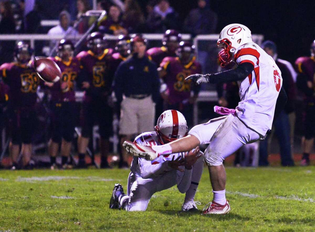 Guilderland's #8 Andrew Sentz's final second field goal is good for the win in their Class AA quarterfinal football game against Colonie Friday Oct. 24, 2013, in Colonie, NY. (John Carl D'Annibale / Times Union)