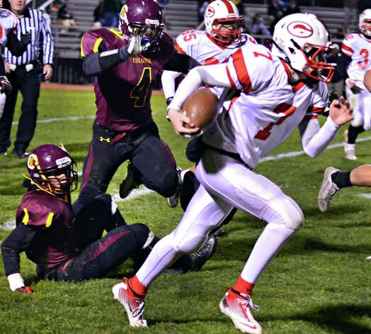 Guilderland QB #7 Frank Gallo scrambles away from Colonie defenders during the Class AA quarterfinal football game Friday Oct. 24, 2013, in Colonie, NY.  (John Carl D'Annibale / Times Union) Photo: John Carl D'Annibale / 00024382A