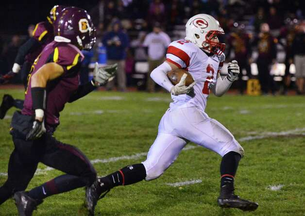 Guilderland's #2 Ryan Gallop, at right, out runs Colonie defenders during the Class AA quarterfinal football game Friday Oct. 24, 2013, in Colonie, NY.  (John Carl D'Annibale / Times Union) Photo: John Carl D'Annibale / 00024382A