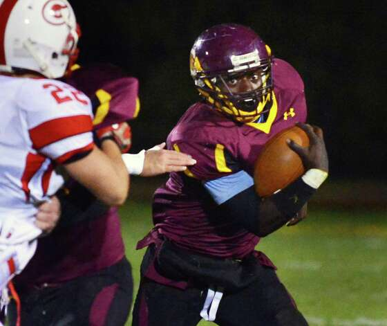 Colonie's Kevon Johnson, at right, carries the ball during the Class AA quarterfinal football game against Guilderland Friday Oct. 24, 2013, in Colonie, NY.  (John Carl D'Annibale / Times Union) Photo: John Carl D'Annibale / 00024382A