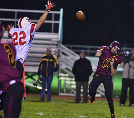 Colonie QB #15 Will McCann, at right,  completes a pass to Kevon Johnson during the Class AA quarterfinal football game against Guilderland Friday Oct. 24, 2013, in Colonie, NY.  (John Carl D'Annibale / Times Union) Photo: John Carl D'Annibale / 00024382A