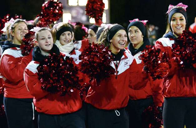 Guilderland cheerleaders during the Class AA quarterfinal game against Colonie High Friday Oct. 24, 2013, in Colonie, NY.  (John Carl D'Annibale / Times Union) Photo: John Carl D'Annibale / 00024382A