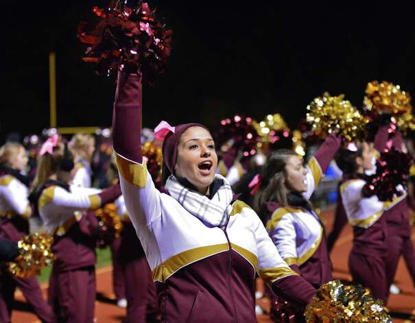 Colonie cheerleader Adriana Dorazio during the Class AA quarterfinal game against Guilderland High Friday Oct. 24, 2013, in Colonie, NY.  (John Carl D'Annibale / Times Union) Photo: John Carl D'Annibale / 00024382A