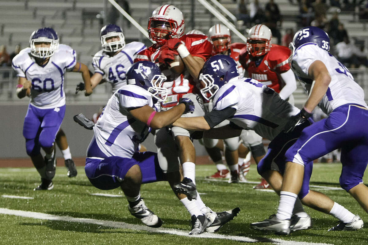 Judson's Brandon Sanders (middle) runs between a couple of San Marcos defenders for a touchdown during the first quarter at Rutledge Stadium. With the victory, the Rockets set a state record with their 37th consecutive winning season.