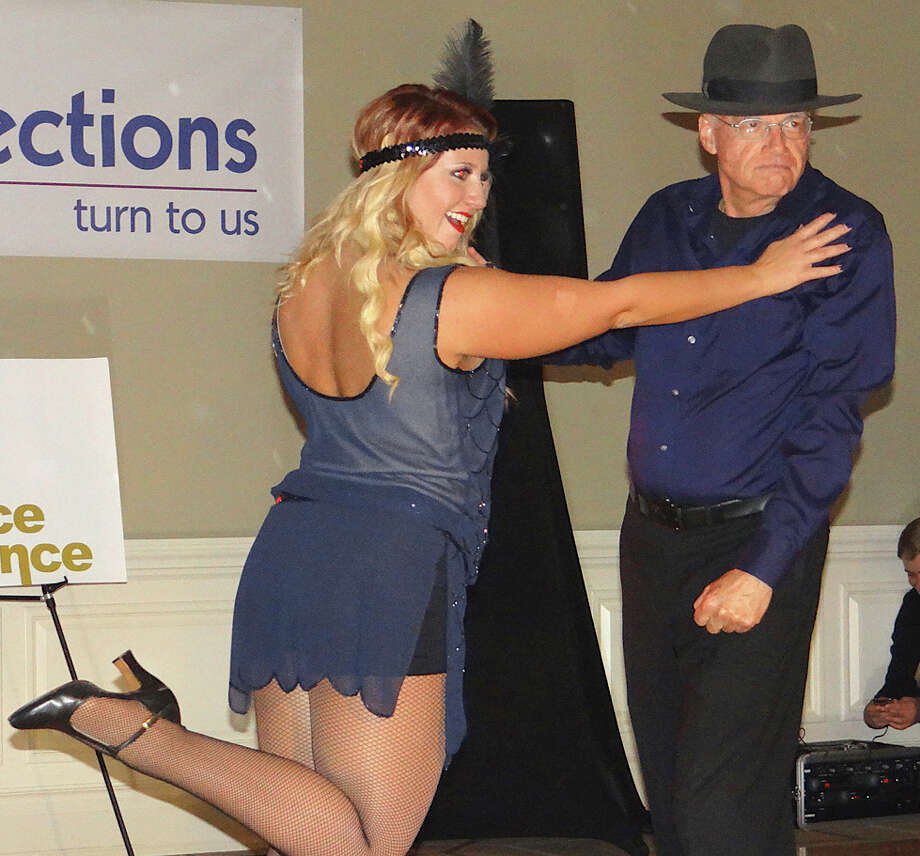 "Kayla Borsari and the Rev. Charles Allen perform at Positive Directions' ""A Chance to Dance"" fundraising event Friday evening at the Patterson Club in Fairfield. Photo: Mike Lauterborn / Fairfield Citizen contributed"