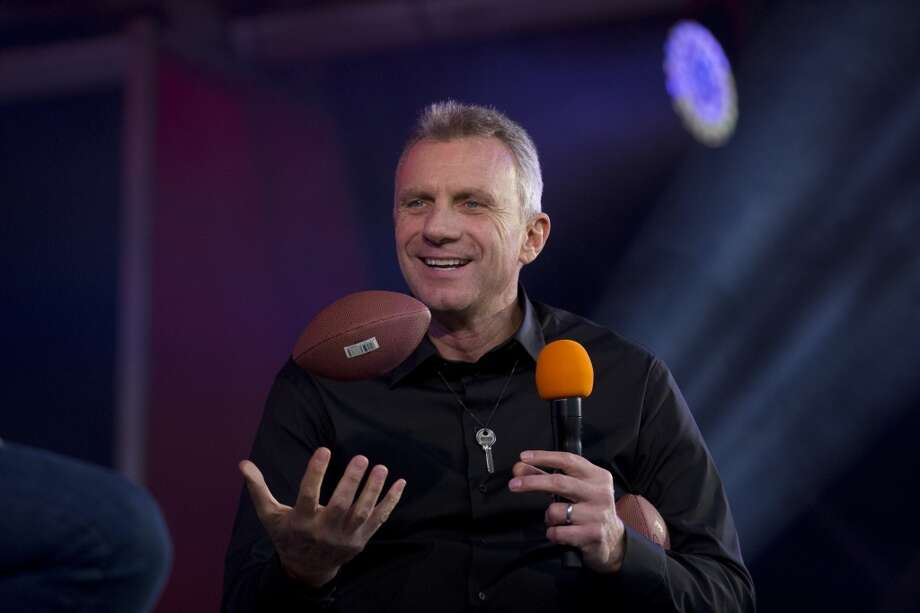 Former San Francisco 49ers quarterback Joe Montana throws a mini ball in the air as he is interviewed on stage during an NFL fan rally in Trafalgar Square, London, Saturday, Oct. 26, 2013.  The San Francisco 49ers are due to play the the Jacksonville Jaguars at Wembley stadium in London on Sunday, Oct. 27 in a regular season NFL game.  (AP Photo/Matt Dunham) Photo: Matt Dunham, Associated Press