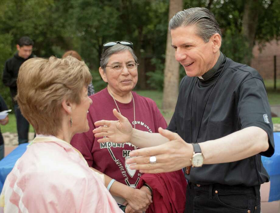 Archbishop of San Antonio, Gustavo Garcia-Siller, right, greets Trudy Brink, left, and Sister Cecilia Rodriguez, of the Sisters of the Sacred Heart of Jesus, before embarking on a pilgrimage to draw more people into vocational positions within the Catholic Church, Saturday, Oct. 26, 2013, at Mission Concepcion in San Antonio. (Darren Abate/For the Express-News) Photo: Darren Abate, For The San Antonio Express-News