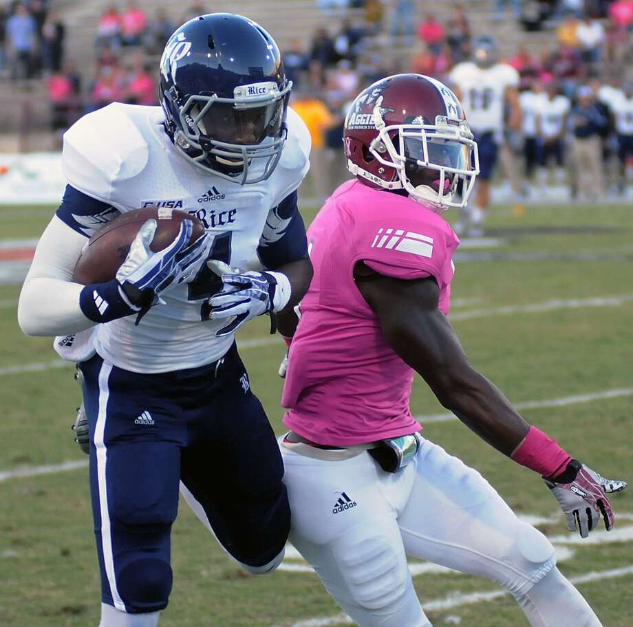 Oct. 19: Rice 45, New Mexico State 19Record: 5-2Rice wide receiver Dennis Parks grabs a long pass from quarterback Taylor McHargue as New Mexico State's Darien Johnson defends Photo: Robin Zielinski, Associated Press
