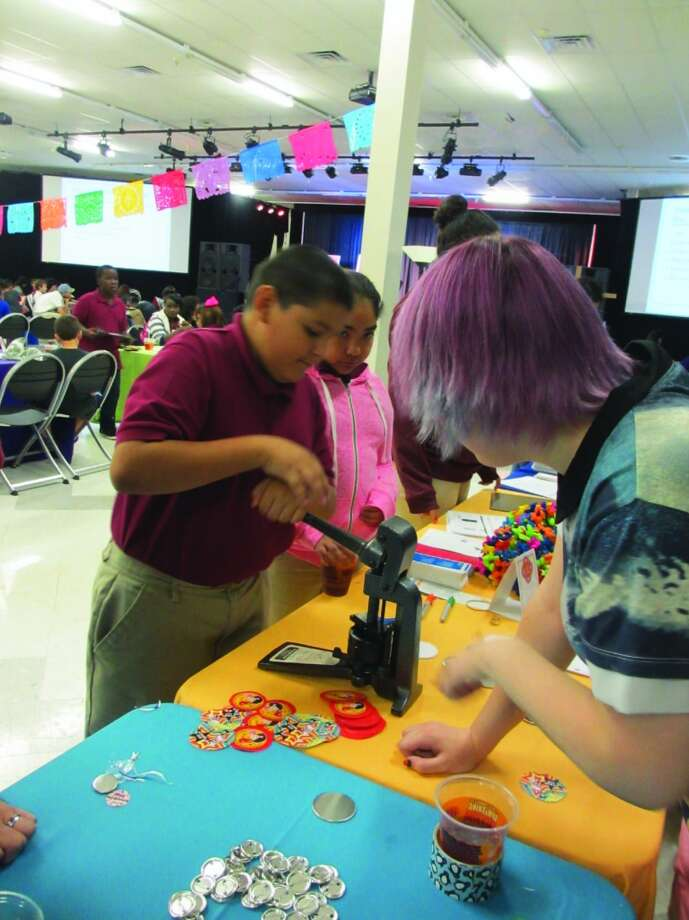 When attendees weren't listening to authors or getting autographs on their new books, they could sign up for a library card and make buttons with a volunteer. Photo: Terry Scott Bertling, San Antonio Express-News