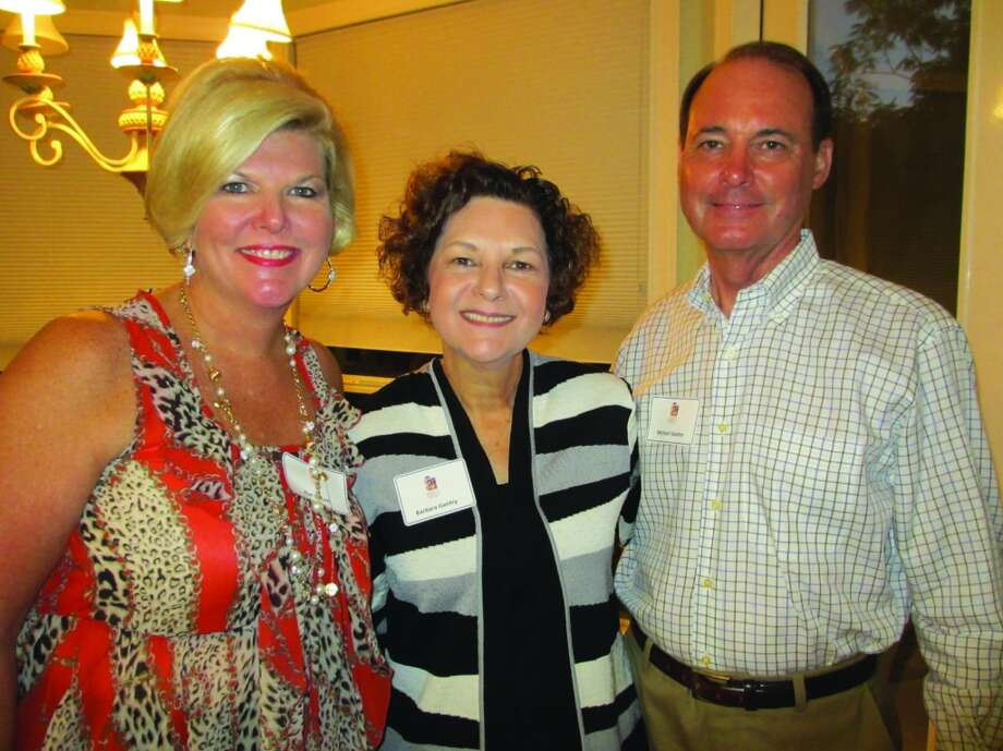 Event chairwoman Kim Gillum visits with honorary  chair and mistress of ceremonies Barbara B. Genry and her husband Michael Gentry at a Friday night author reception. Photo: Terry Scott Bertling, San Antonio Express-News