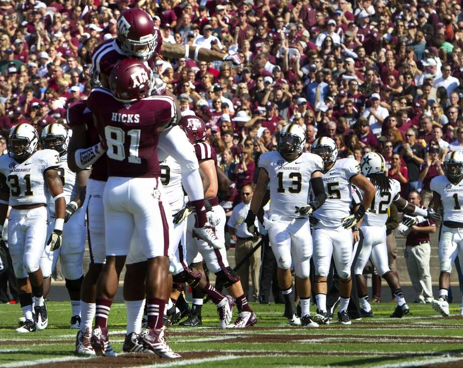Texas A&M receiver LaQuivionte Gonzalez celebrates a touchdown against Vanderbilt. Photo: Cody Duty, Houston Chronicle