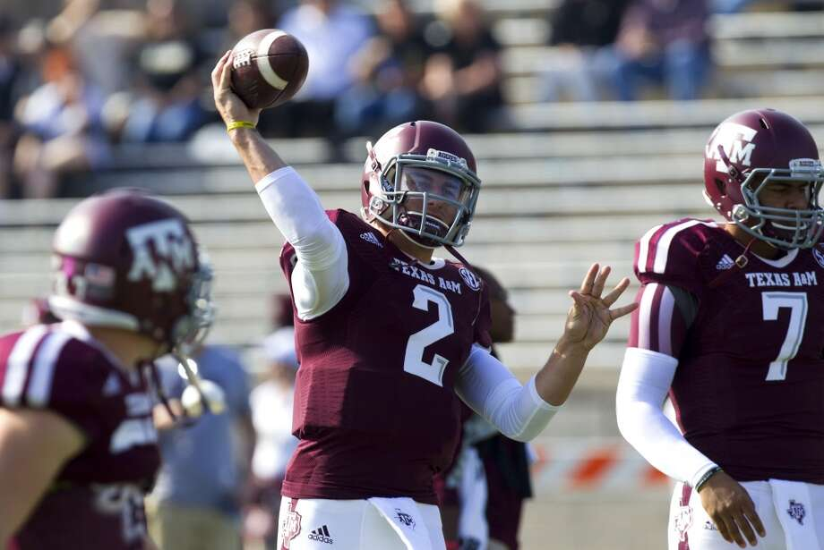 Texas A&M quarterback Johnny Manziel warms up before playing Vanderbilt. Photo: Cody Duty, Houston Chronicle