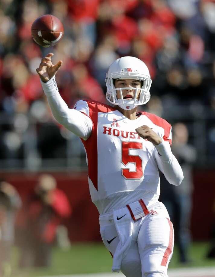 Oct. 26: UH 49, Rutgers 14Record: 6-1UH quarterback John O'Korn makes a pass against Rutgers. Photo: Mel Evans, Associated Press
