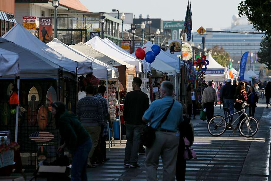 Vendors offer a variety of wares from tents set up along Jefferson Street. With no Fleet Week this year, waterfront merchants organized a weekend festival. Photo: Raphael Kluzniok, The Chronicle