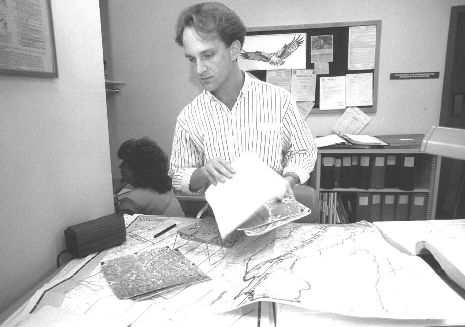 Russell Clifton, Greenwich's acting wetlands compliance officer, looks through papers at the agency's town hall office on Oct. 28, 1988. The agency was overburdened with work after the departures of two employees. Photo: File Photo, Greenwich Time / Greenwich Time