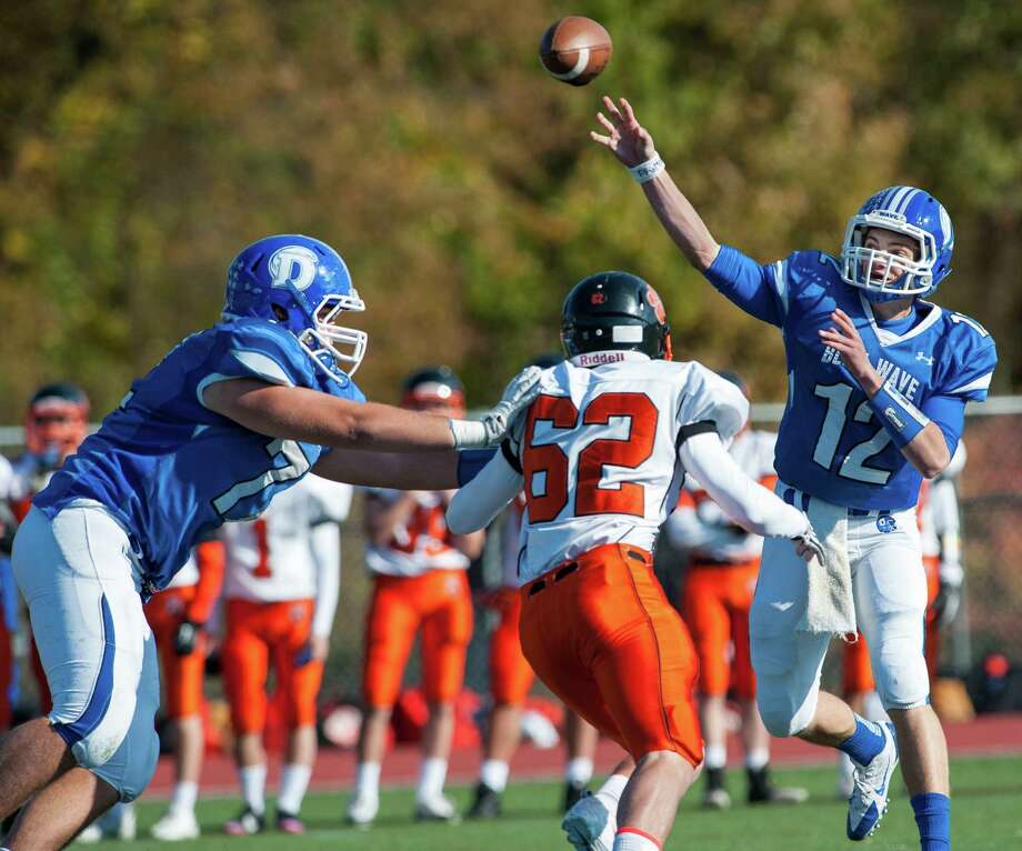 Darien high school quarterback Silas Wyper throws the ball downfield during a football game against Ridgefield high school played at Darien high school, Darien, CT on Saturday, October, 26th, 2013 Photo: Mark Conrad / Stamford Advocate Freelance