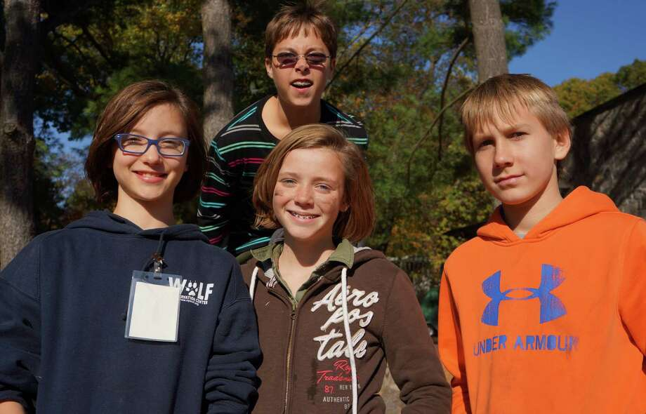 At Earthplace's pumpkin-carving event on Saturday, from left: Alex Randall, Courntey Hoile, Audrey Kramer and Conner Calzone. Photo: Todd Tracy / Westport News contributed