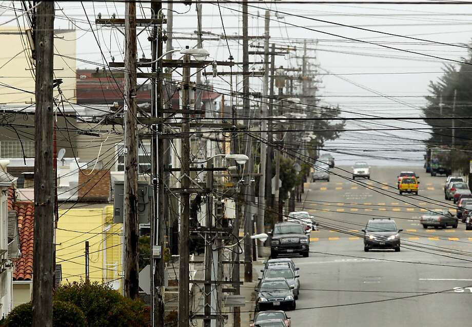 Cluttered power lines are giving way to solar cells as more businesses and homeowners generate their own energy, forcing utilities to find new ways to satisfy customers and shareholders. Photo: Michael Macor, The Chronicle