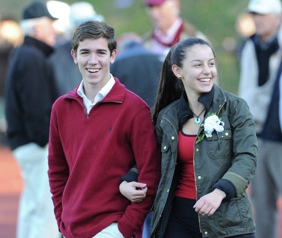 The Greenwich High School Prince and Princess, Federico Mato, left, and Margo Buck, are introduced as part of the Greenwich High School Homecoming activities during halftime of the football game between Greenwich and Fairfield Warde High School at Greenwich, Saturday, Oct. 26, 2013. Photo: Bob Luckey / Greenwich Time
