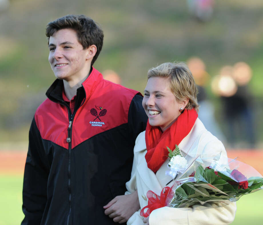 The Greenwich High School King and Queen, Henry Ricardi, left, and Nicole Graham, are introduced as part of the Greenwich High School Homecoming activities during halftime of the football game between Greenwich and Fairfield Warde High School at Greenwich, Saturday, Oct. 26, 2013. Photo: Bob Luckey / Greenwich Time