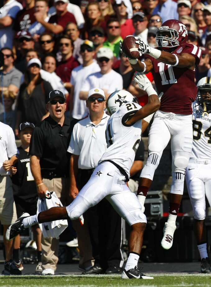 Vanderbilt Commodores defensive back Paris Head pressures Texas A&M Aggies wide receiver Derel Walker as he reels in a catch during the first half of a college football game at Kyle Field Saturday, Oct. 26, 2013, in College Station. Photo: Cody Duty, Houston Chronicle
