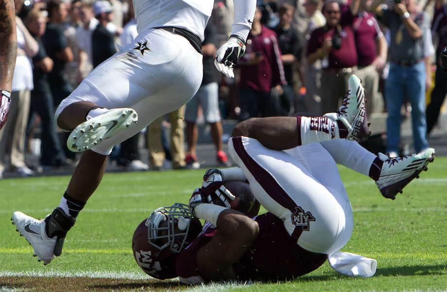 Texas A&M Aggies running back Trey Williams rolls in for a touchdown during the first half of a college football game against the Vanderbilt Commodores at Kyle Field Saturday, Oct. 26, 2013, in College Station. Photo: Cody Duty, Houston Chronicle / © 2013 Houston Chronicle