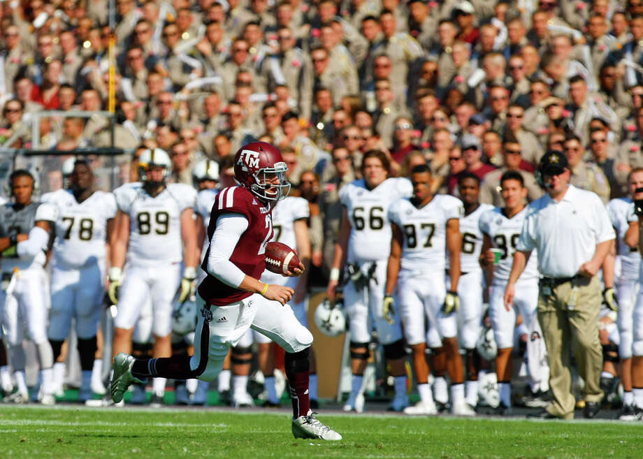 Texas A&M Aggies quarterback Johnny Manziel runs the ball during the first half of a college football game against the Vanderbilt Commodores at Kyle Field Saturday, Oct. 26, 2013, in College Station. The Aggies won 56-24. Photo: Cody Duty, Houston Chronicle / © 2013 Houston Chronicle