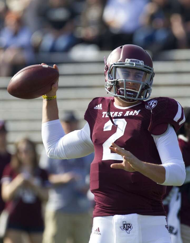 Texas A&M Aggies quarterback Johnny Manziel warms up before an NCAA college football game against the Vanderbilt Commodores at Kyle Field Saturday, Oct. 26, 2013, in College Station. Photo: Cody Duty, Houston Chronicle