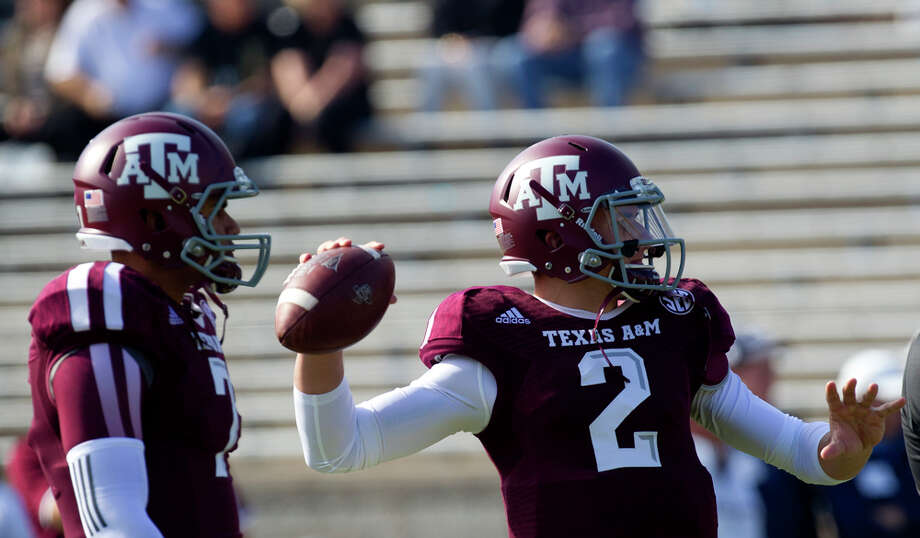 Texas A&M Aggies quarterback Johnny Manziel warms up before an NCAA college football game against the Vanderbilt Commodores at Kyle Field Saturday, Oct. 26, 2013, in College Station. Photo: Cody Duty, Houston Chronicle / © 2013 Houston Chronicle