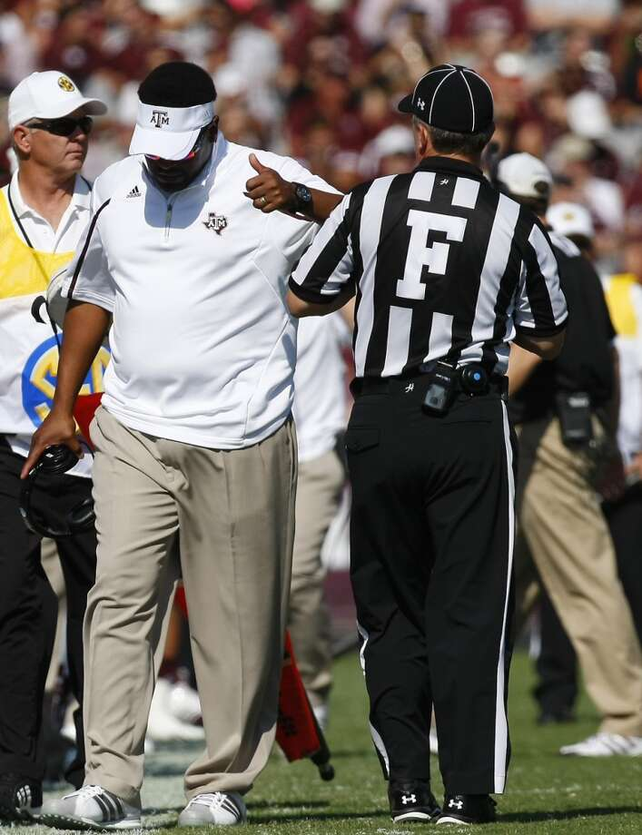 Texas A&M Aggies head coach Kevin Sumlin signals a thumbs up after a reversal of a controversial call during the first half of a college football game against the Vanderbilt Commodores at Kyle Field Saturday, Oct. 26, 2013, in College Station. Photo: Cody Duty, Houston Chronicle