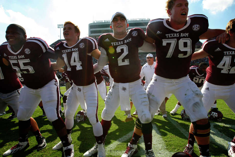 Texas A&M Aggies quarterback Johnny Manziel, center, celebrates with teammates after a 56-24 win over the Vanderbilt Commodores at Kyle Field Saturday, Oct. 26, 2013, in College Station. Photo: Cody Duty, Houston Chronicle / © 2013 Houston Chronicle