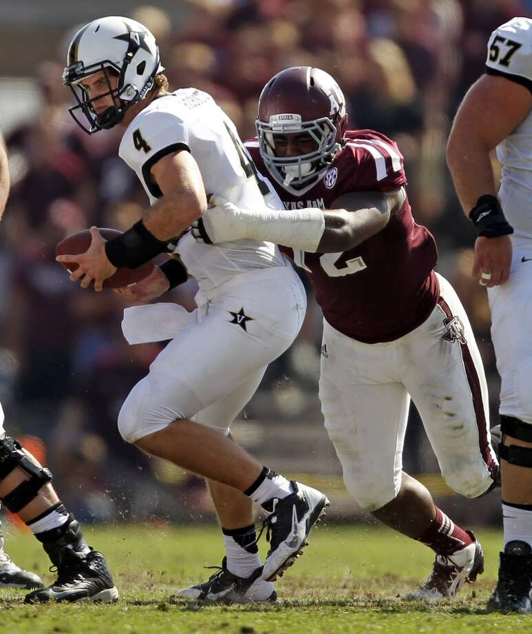 Vanderbilt's Patton Robinette (4) is sacked by Texas A&M's Gavin Stansbury during the first half of an NCAA college football game, Saturday, Oct. 26, 2013, in College Station, Texas. Photo: Eric Christian Smith, Associated Press