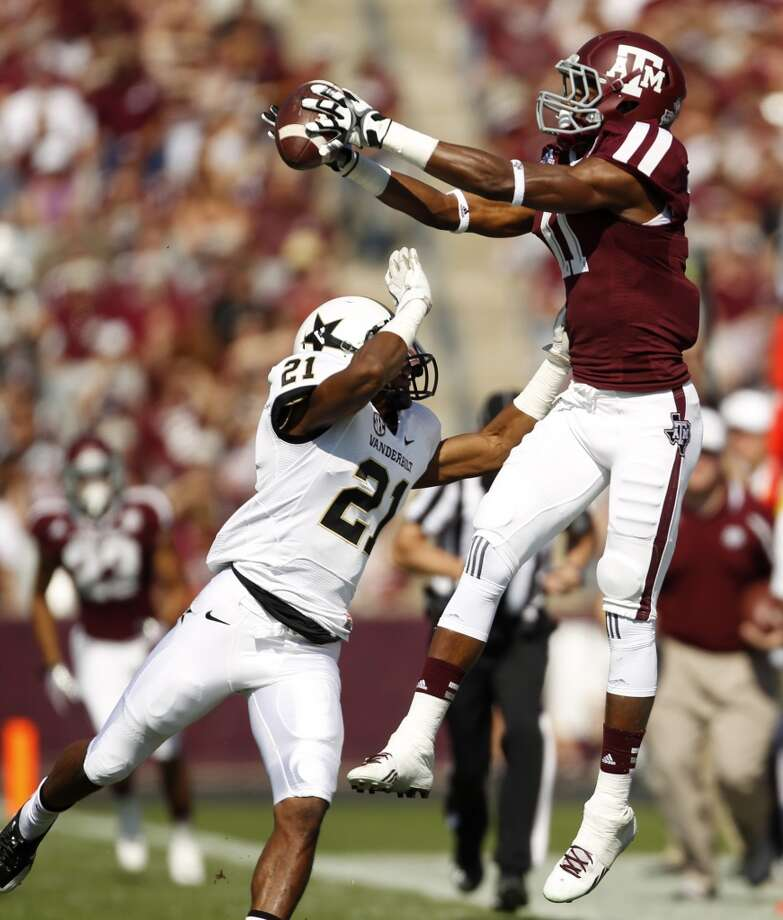 Texas A&M's Derel Walker, right, catches a pass over Vanderbilt's Paris Head (21) during the first half of an NCAA football game, Saturday, Oct. 26, 2013, in College Station, Texas. Photo: Eric Christian Smith, Associated Press