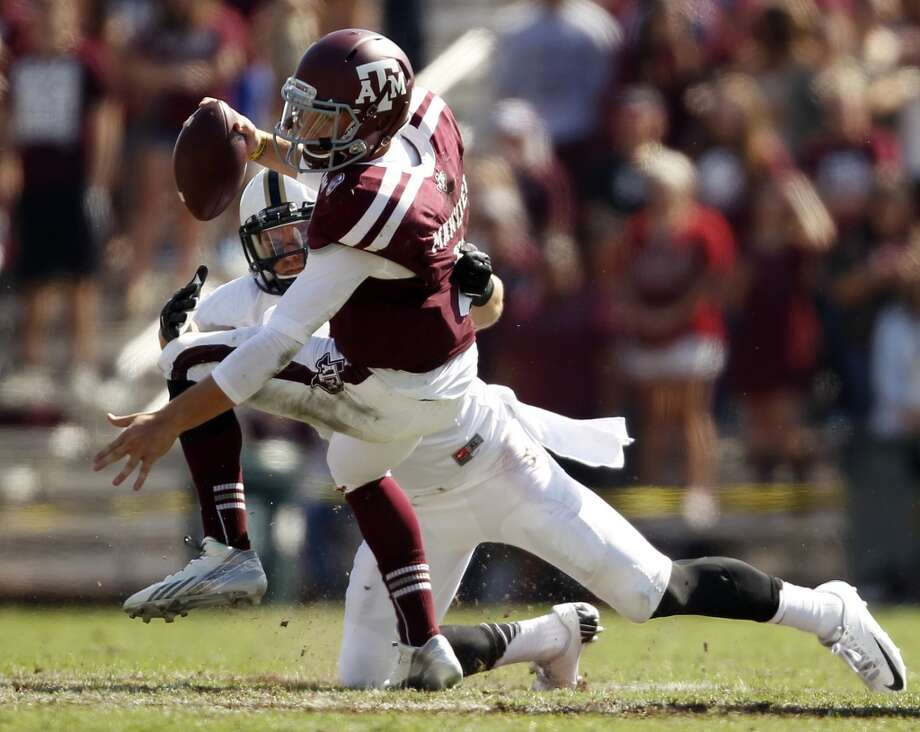 Texas A&M's Johnny Manziel is sacked by Vanderbilt's Kyle Woestmann during the first half of an NCAA football game, Saturday, Oct. 26, 2013, in College Station, Texas. Photo: Eric Christian Smith, Associated Press