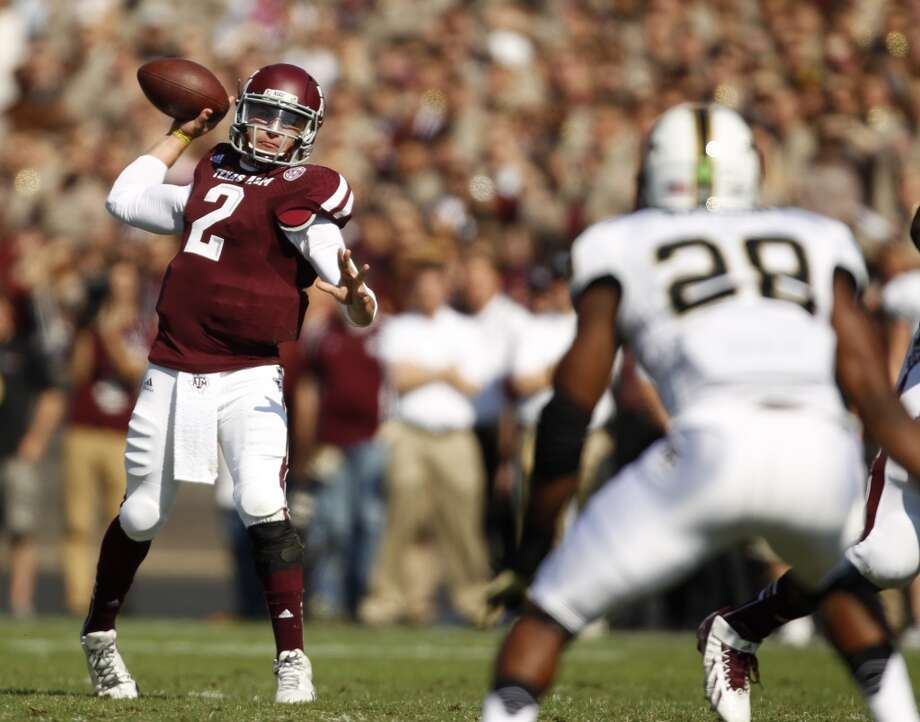Texas A&M's Johnny Manziel passes the ball during the first half of an NCAA football game against Vanderbilt, Saturday, Oct. 26, 2013, in College Station, Texas. Photo: Eric Christian Smith, Associated Press