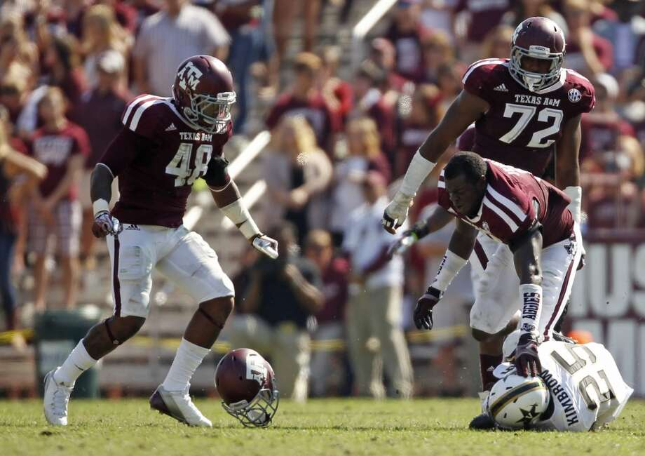 Texas A&M's Steven Jenkins, right, loses his helmet after tackling Vanderbilt's Brian Kimbrow (25) during the first half of an NCAA college football game, Saturday, Oct. 26, 2013, in College Station, Texas. Photo: Eric Christian Smith, Associated Press